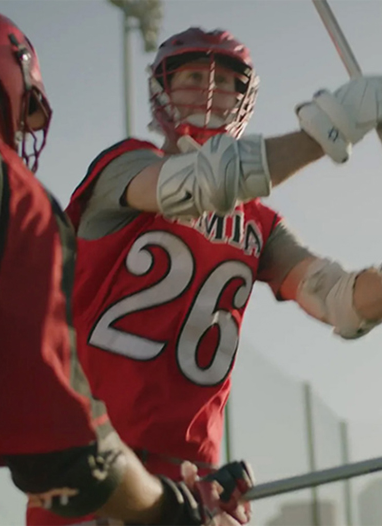 Lacrosse player in red uniform