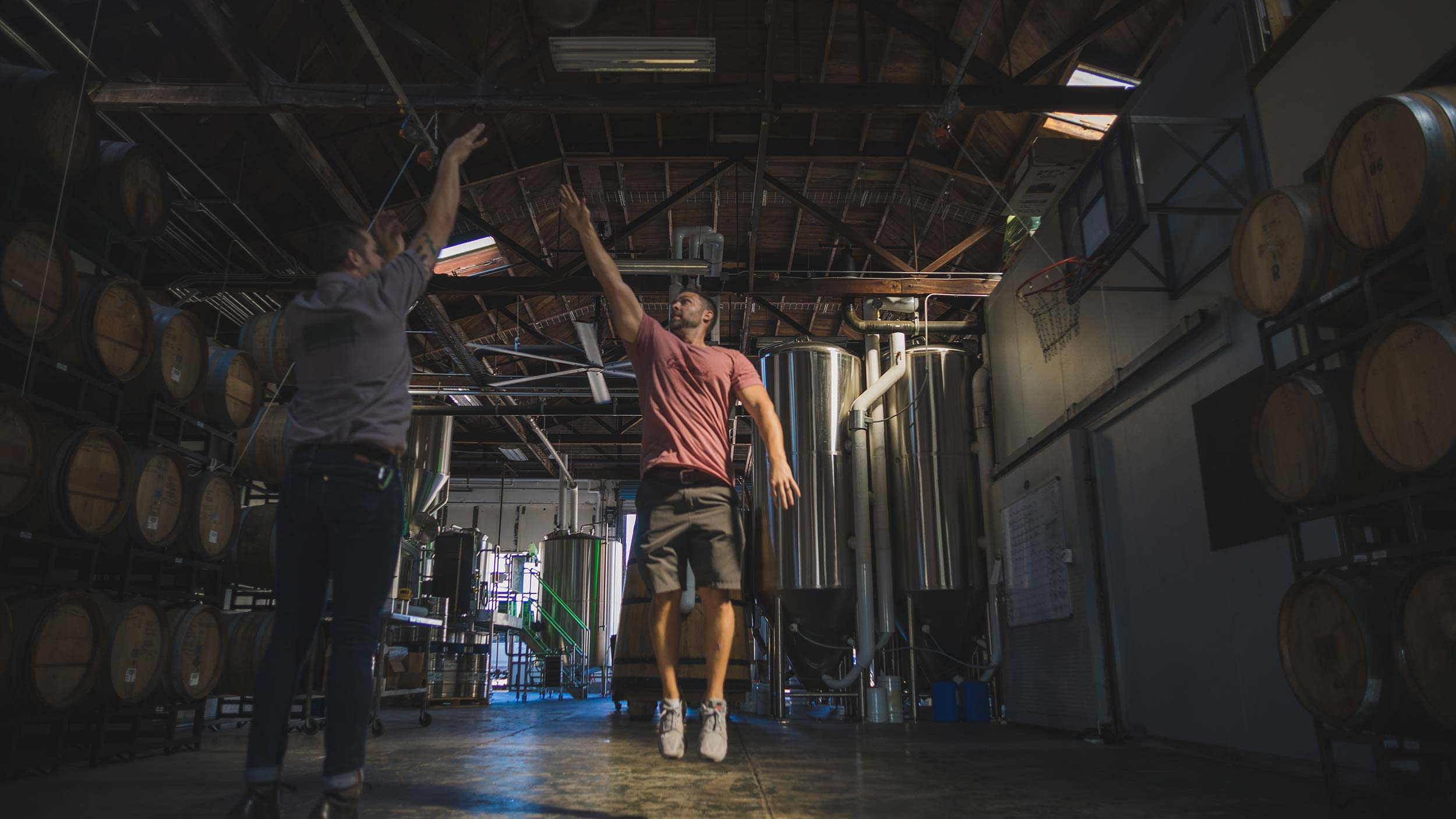 men playing basketball in brewery