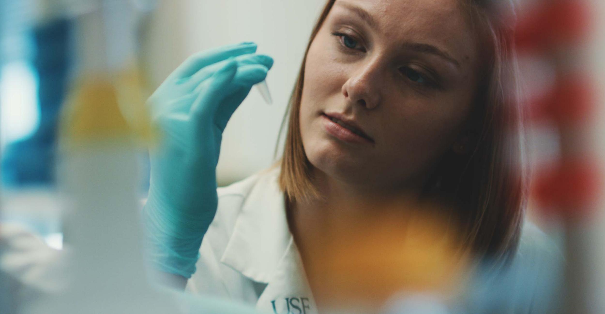 usf student examining test tube