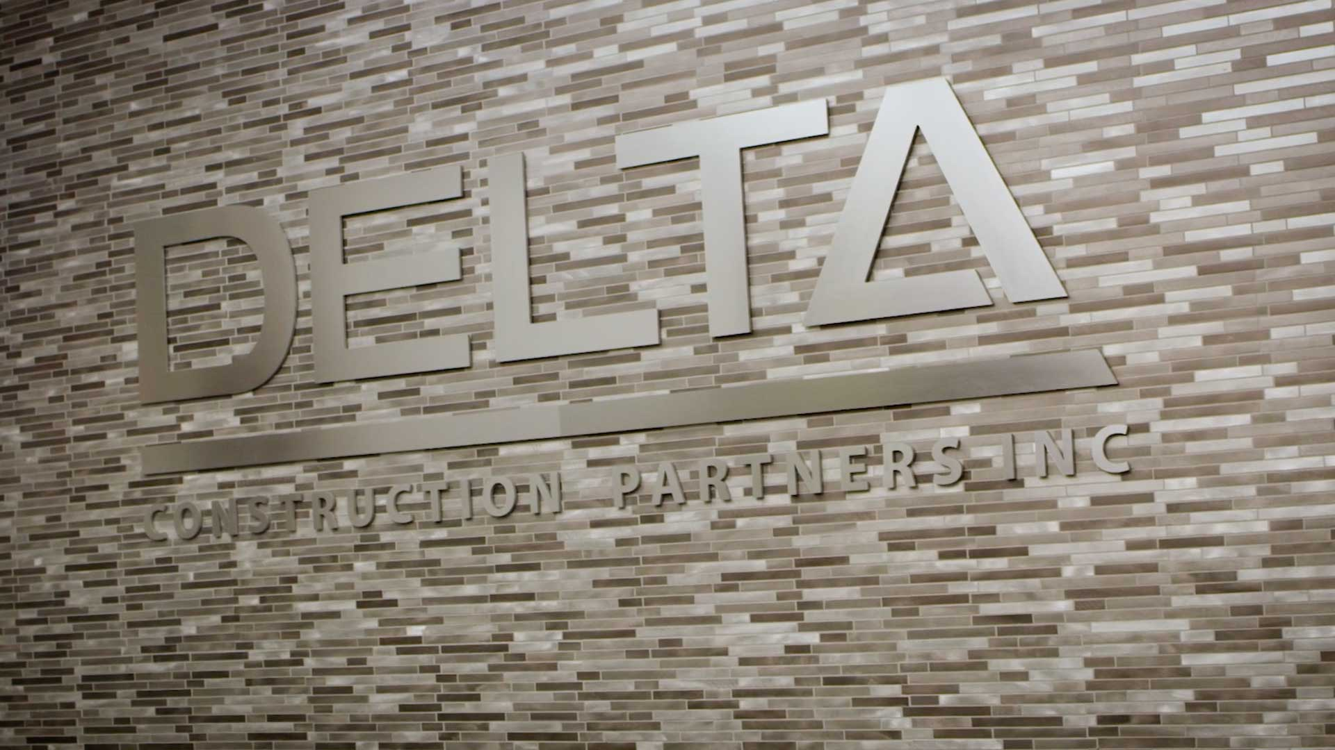 Delta Construction logo on wall