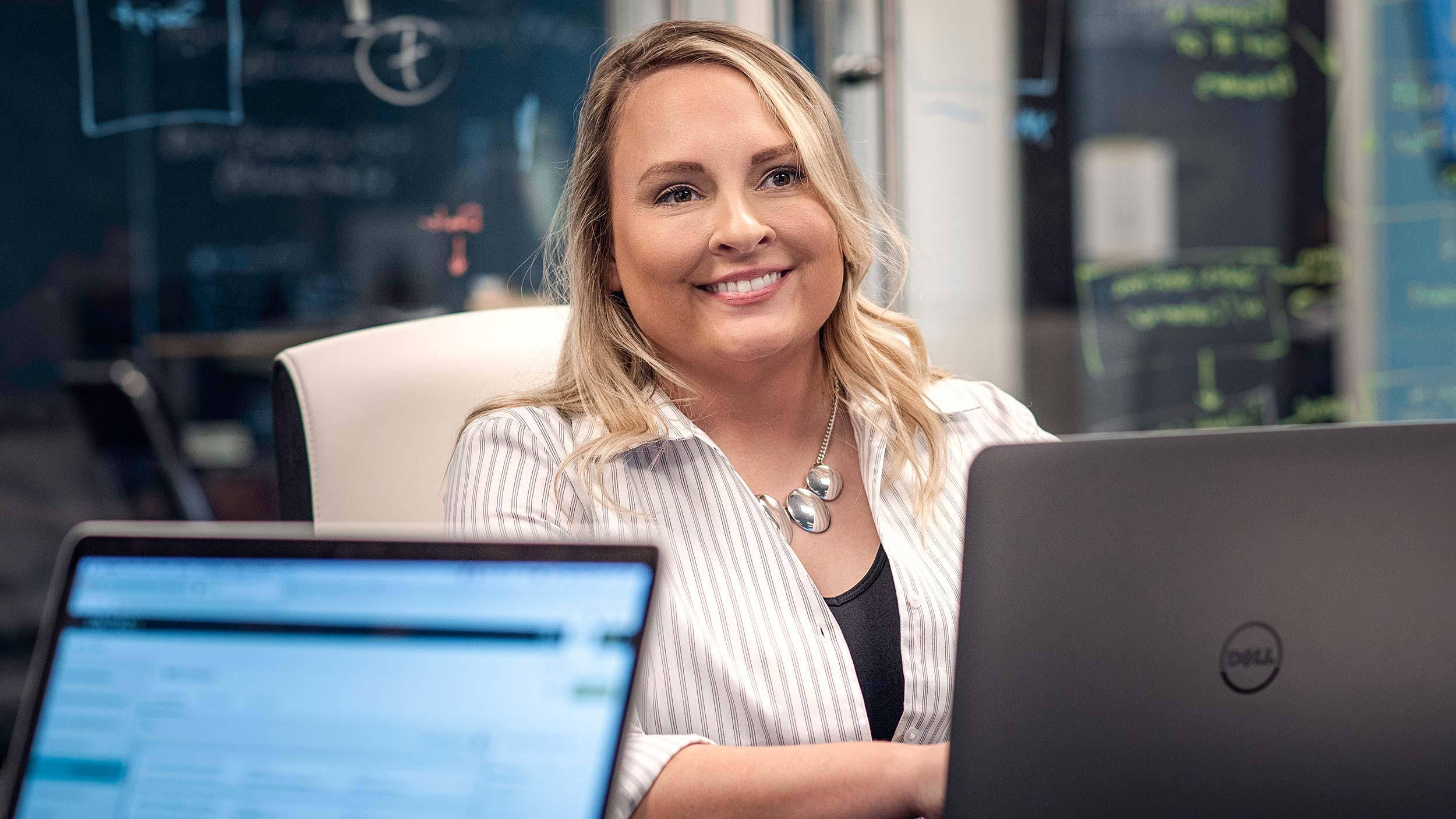smiling woman working at laptop